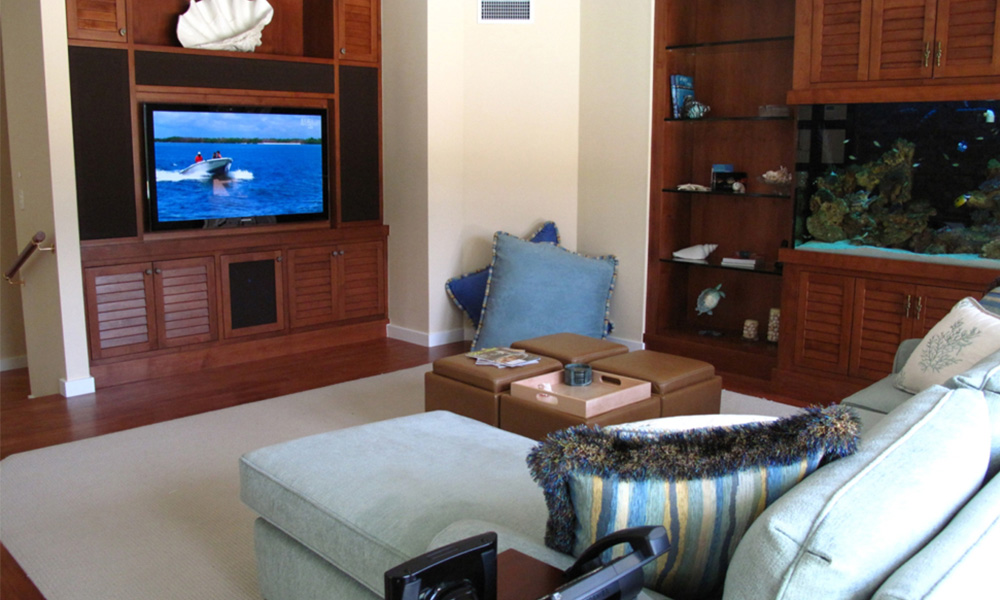 aquarium, blue sofa, built-in cabinets, Custom Cabinets, family room, tropical