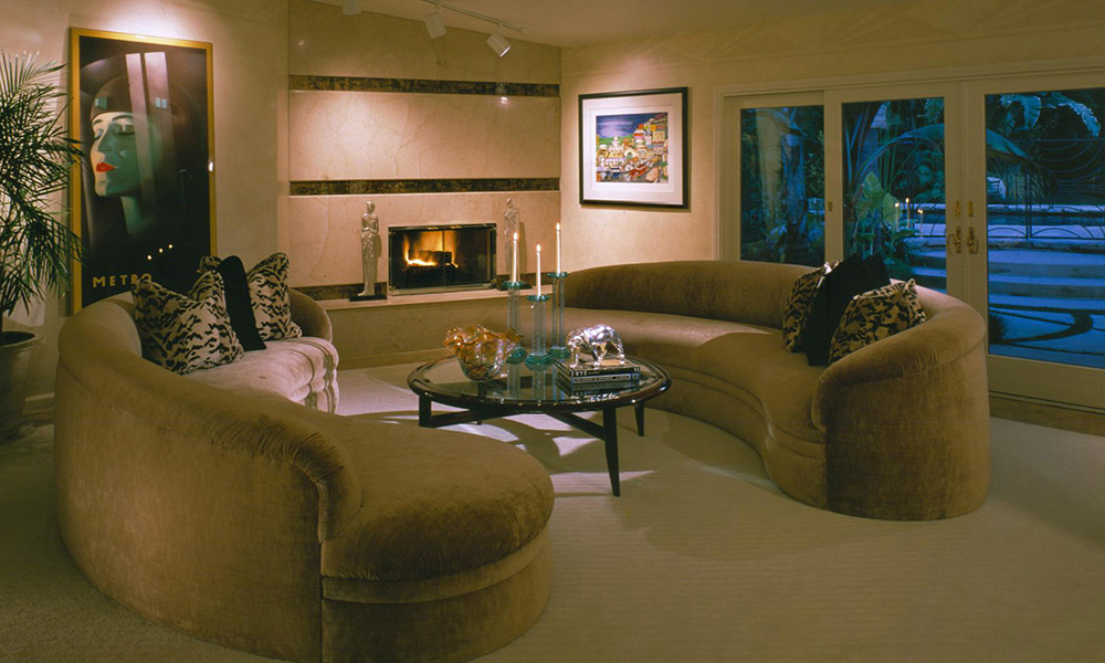 c shaped sofa,  velvet curved sofa, art deco living room, hollywood flair, contemporary fireplace, sophisticated living room